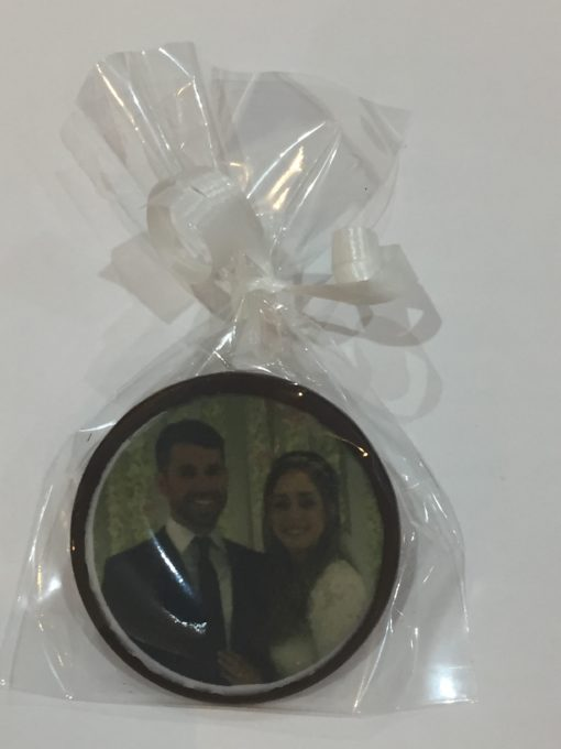 photo of couple on chocolate disk